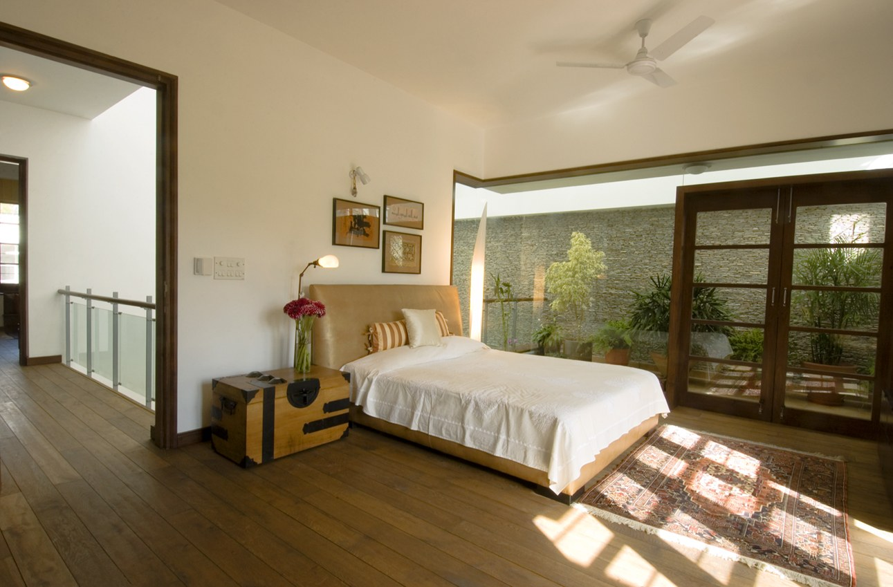 Bedroom With Wooden Flooring And Wooden Cabinet by narayan moorthy Bedroom Contemporary | Interior Design Photos & Ideas