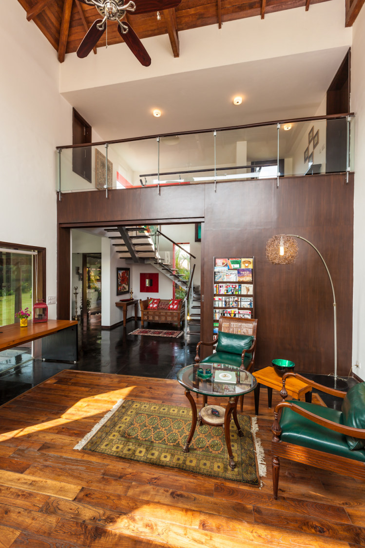 Living Room With Leather Seaweed Green Chair And Glass Top Table by narayan moorthy Living-room Traditional | Interior Design Photos & Ideas