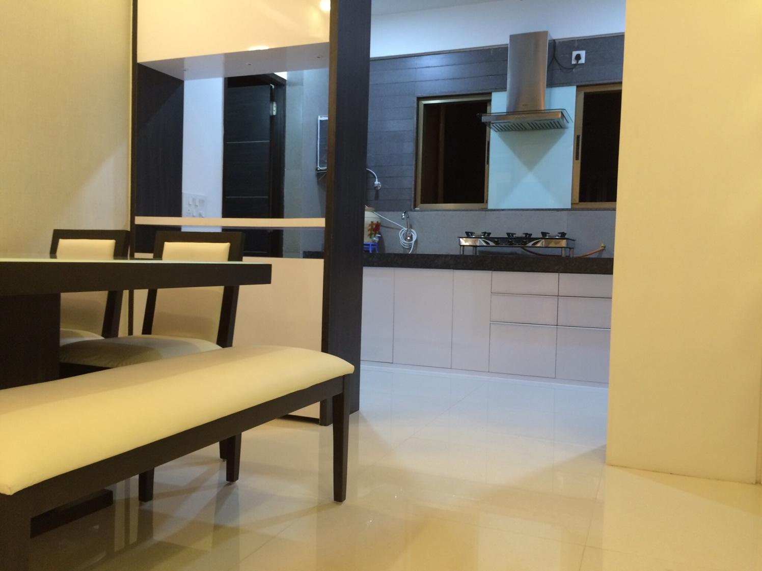 Dinning space with marble flooring  and white  furniture by Vatsal Hadvani Modular-kitchen Modern | Interior Design Photos & Ideas