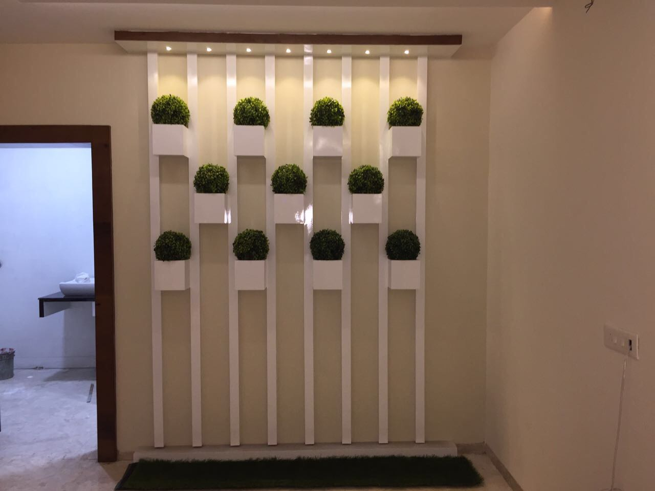 Hallway Decor With Hanging Mini Vases and Recessed Built-in Light by Shravan Hendre Indoor-spaces Modern | Interior Design Photos & Ideas