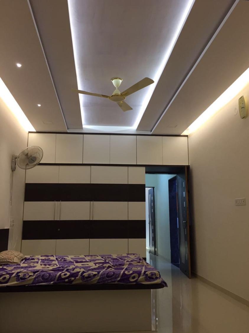 Well-Lit Bedroom With Golden Accent Perimeter Lighting by Shravan Hendre Bedroom Modern | Interior Design Photos & Ideas