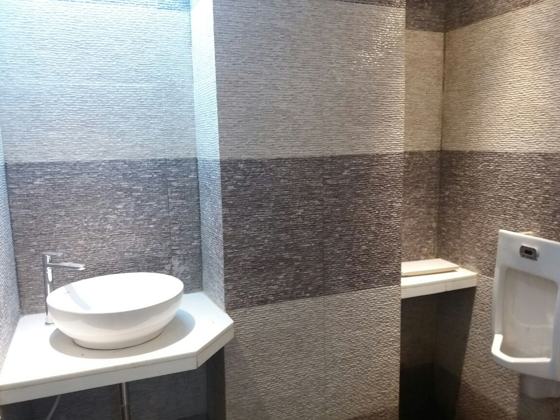Office Toilet Room with Wash and Urinal by Roshan Ashta