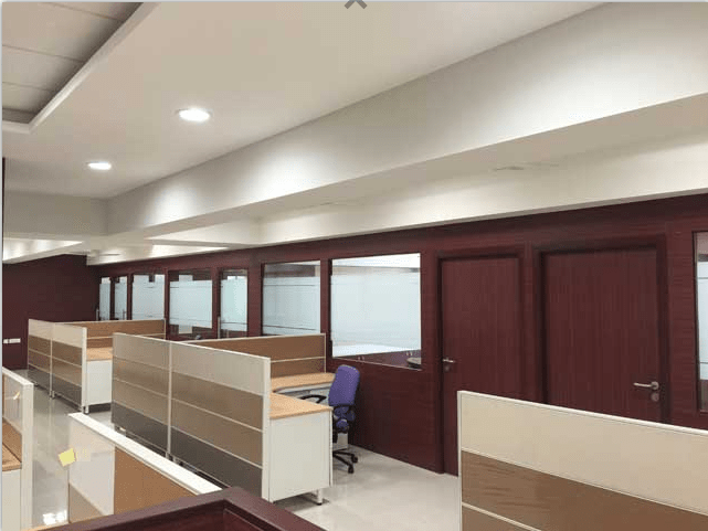 Common Cubicle area with Side meeting rooms by Roshan Ashta