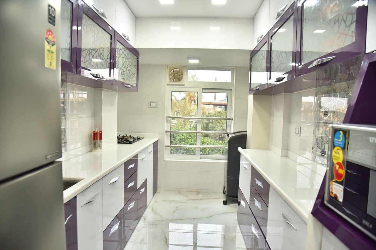 White Themed Kitchen With White and Brown Cabinets by Chirag Sunil Bhandari Modular-kitchen Modern | Interior Design Photos & Ideas