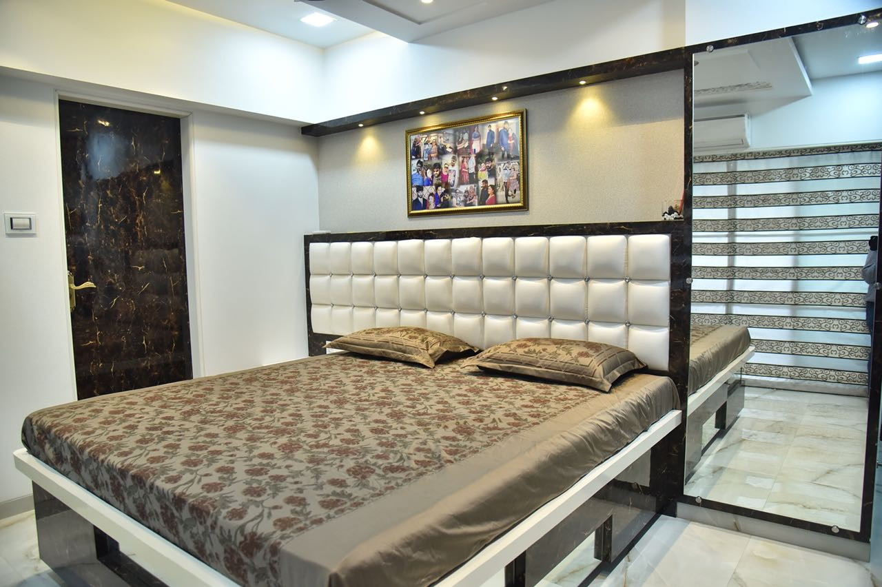 White Themed Master Bedroom With Low-Floor Wooden Bed and White Leather Headrest by Chirag Sunil Bhandari Bedroom Modern | Interior Design Photos & Ideas