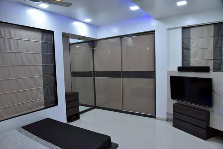Sliding door glass paneled wardrobe with white glossy floor by Simi Jajoo Bedroom Modern | Interior Design Photos & Ideas