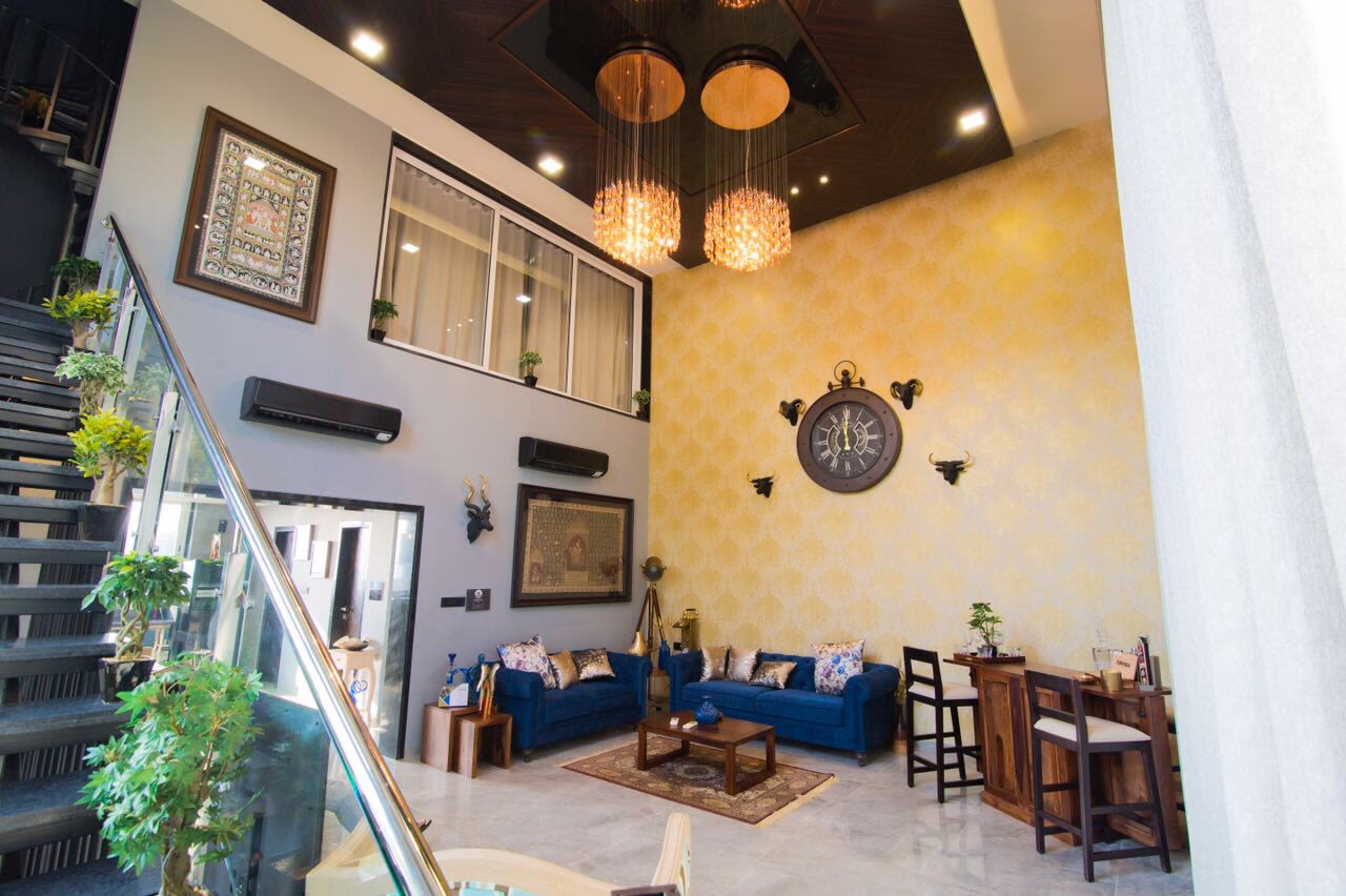 Blue Velvet Sofa And Yellow Chandelier by Dhwani Patel Living-room Vintage | Interior Design Photos & Ideas