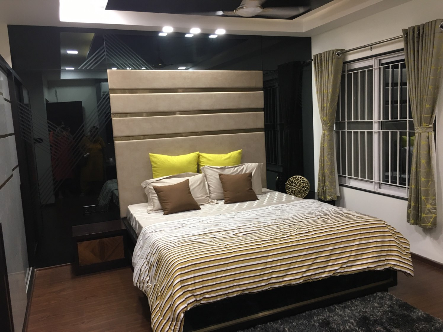 Low Rise Wooden Bed And Beige Cushioned Head Cover by Dhwani Patel Bedroom Contemporary | Interior Design Photos & Ideas
