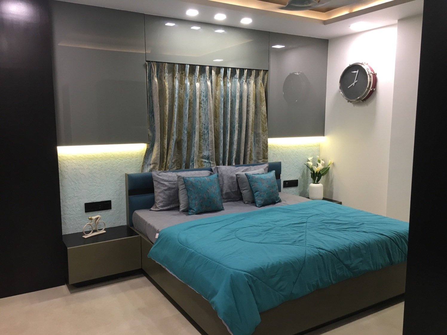 Low Rise Cushioned Bed And Mocha brown Side Table by Dhwani Patel Bedroom Contemporary | Interior Design Photos & Ideas