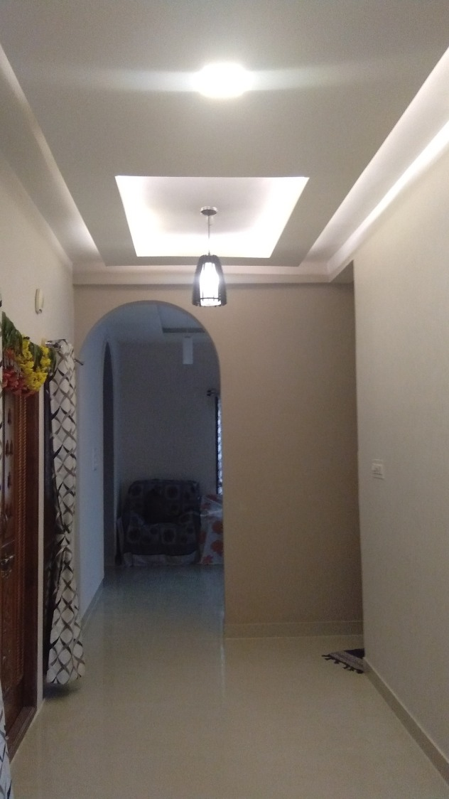 Well-Lit Hallway Decor With Tulip Shaped Pendant Lamp by Tejesh Suthar Indoor-spaces Modern   Interior Design Photos & Ideas