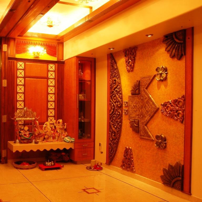 A beautiful traditional pooja room. by Nikhil Indoor-spaces Traditional | Interior Design Photos & Ideas
