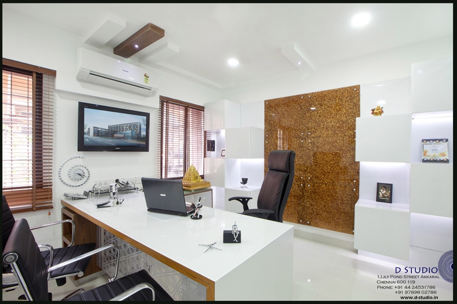 White glossy office with decorative golden Wall panel and Black upholstered swivel chairs by Sarath Sasi P Modern | Interior Design Photos & Ideas