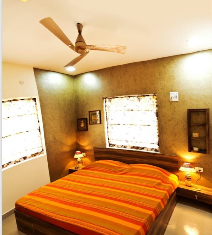 Saffron and orange themed bedroom with golden wallpaper by Sarath Sasi P Bedroom Contemporary | Interior Design Photos & Ideas