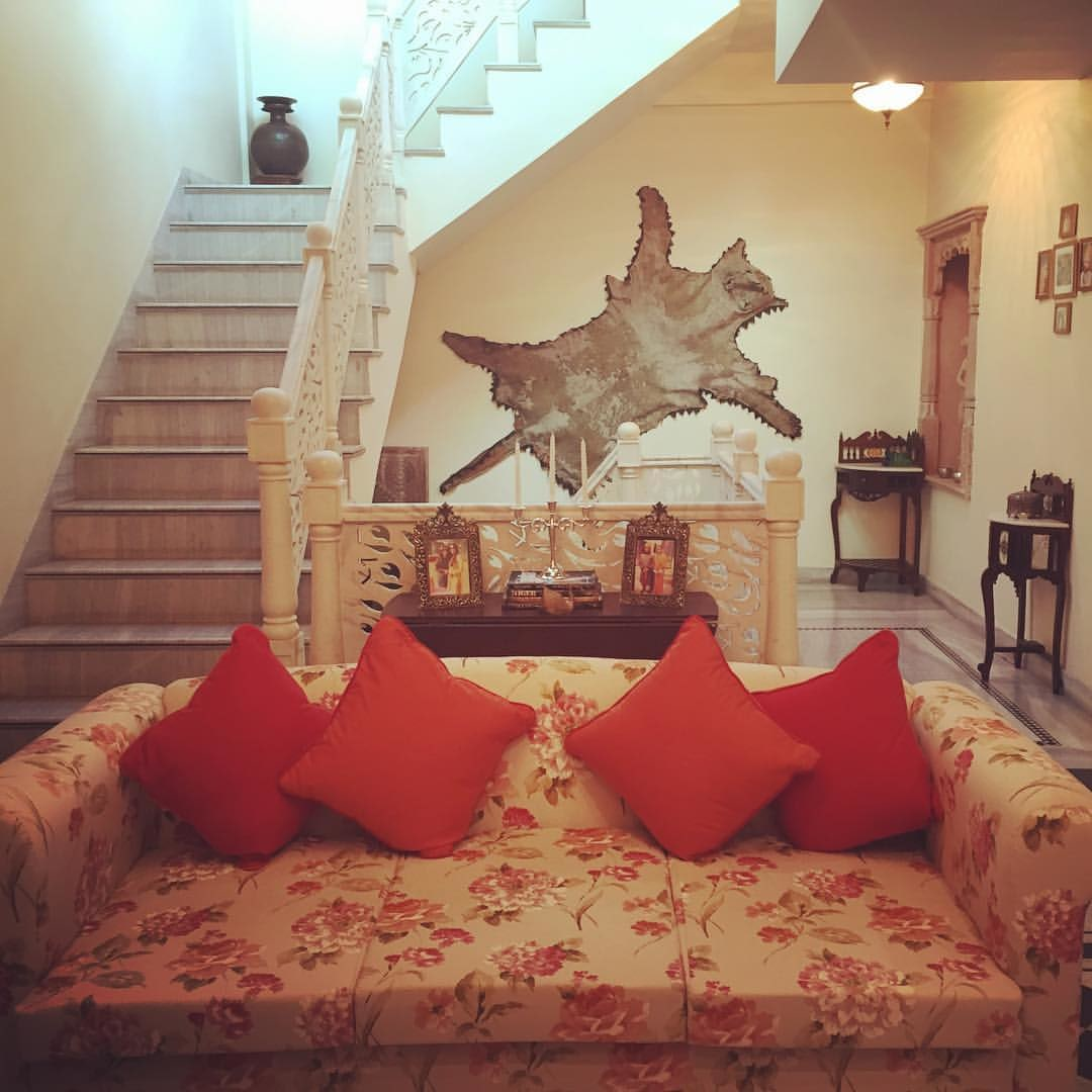 Living room with floral patterned couch and bright orange plush pillow by The Kotri Living-room Traditional   Interior Design Photos & Ideas