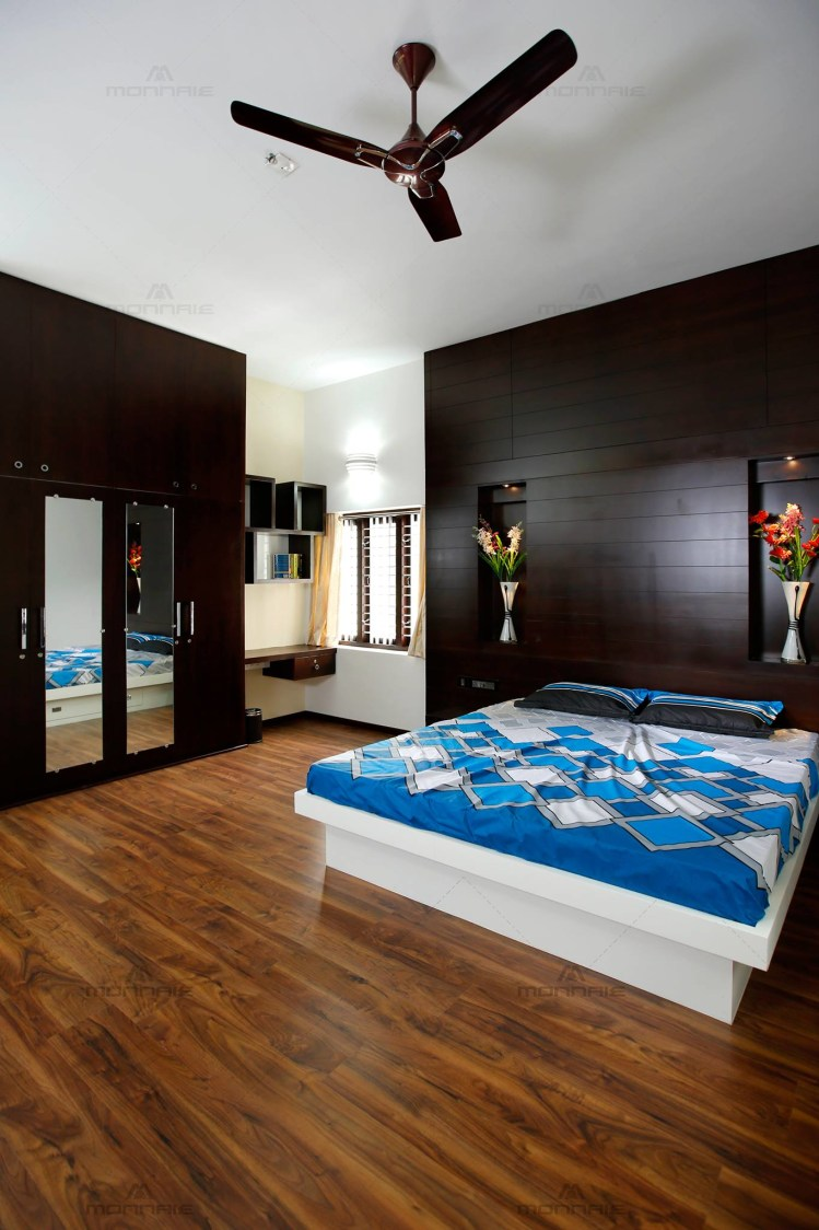 Commodious Master Bedroom with Wood Flooring and King Size ...