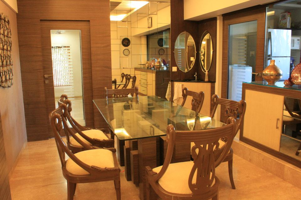 Beige Cushioned Chairs And Glass Top Wooden Table by Sagar Shah Dining-room Traditional | Interior Design Photos & Ideas