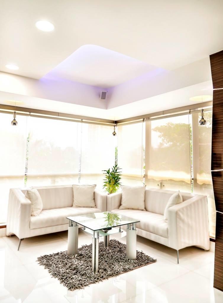 White Tuxedo Sofas With Grey Carpet by Sagar Shah Living-room Minimalistic | Interior Design Photos & Ideas
