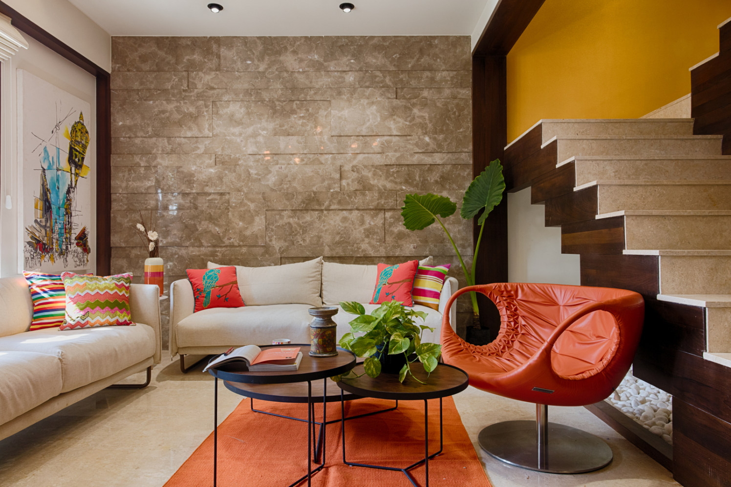 Beige Abstract Wall And Cream Sofas With Patterned Cushions And Orange Lounge Chair by Dhaval Patel Living-room Modern | Interior Design Photos & Ideas