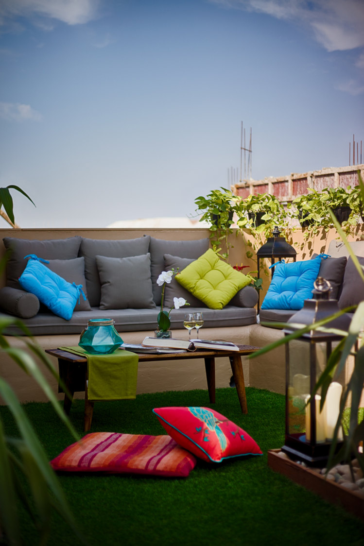 Grey Couch with Colorful Cushions and Synthetic Turf on Floor by Dhaval Patel Open-spaces Contemporary | Interior Design Photos & Ideas