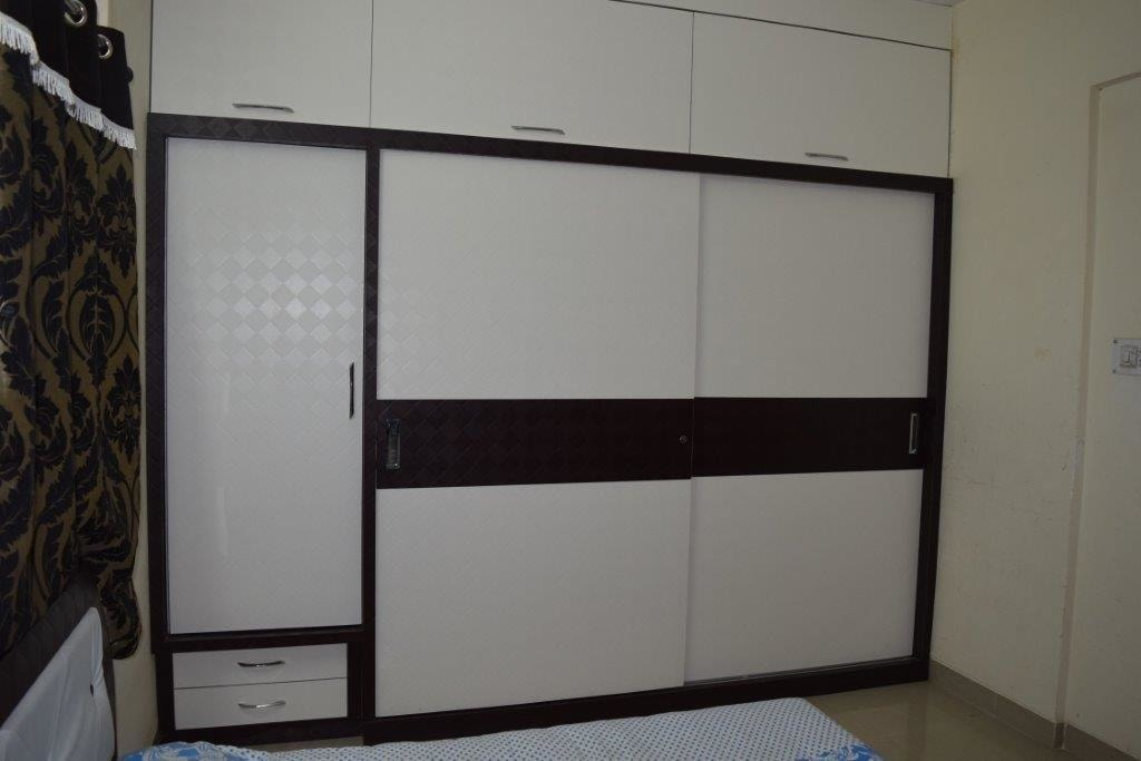 Walnut And White Wood Sliding Cupboard by color's interio Bedroom Contemporary | Interior Design Photos & Ideas