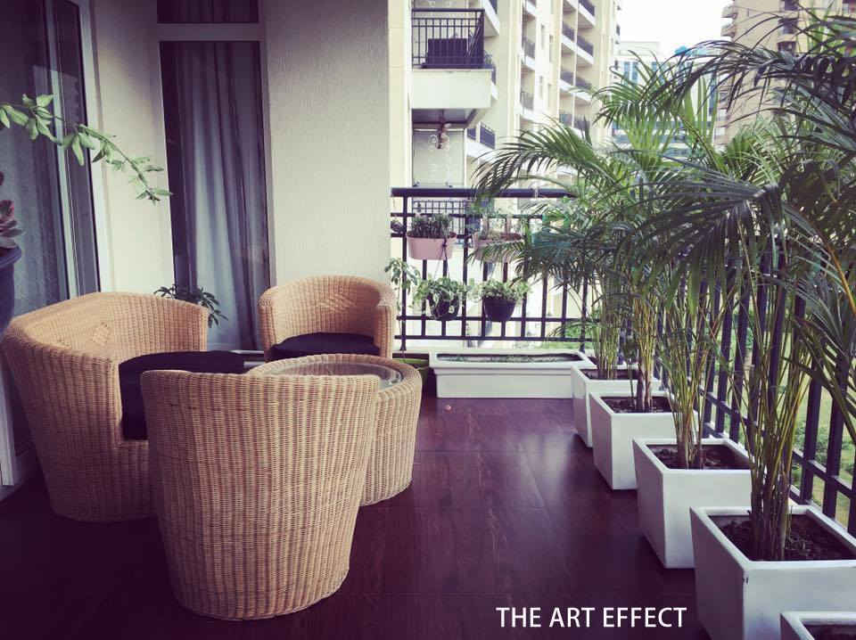 Patio Chairs And Round Table In A Balcony by The Art Effect Open-spaces Contemporary   Interior Design Photos & Ideas