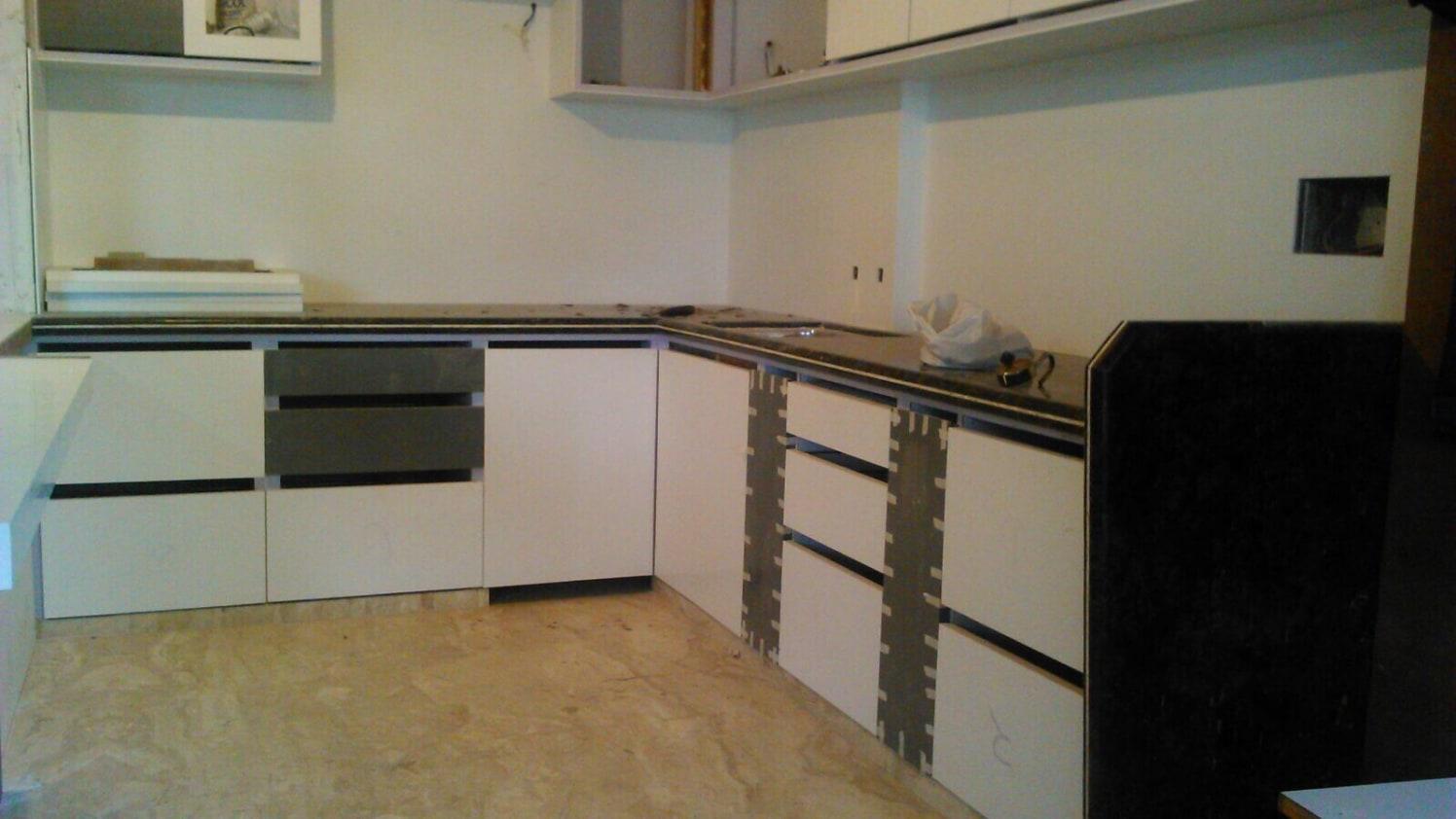 L shape kitchen with marble flooring by kavita.dhotre Modular-kitchen Minimalistic | Interior Design Photos & Ideas