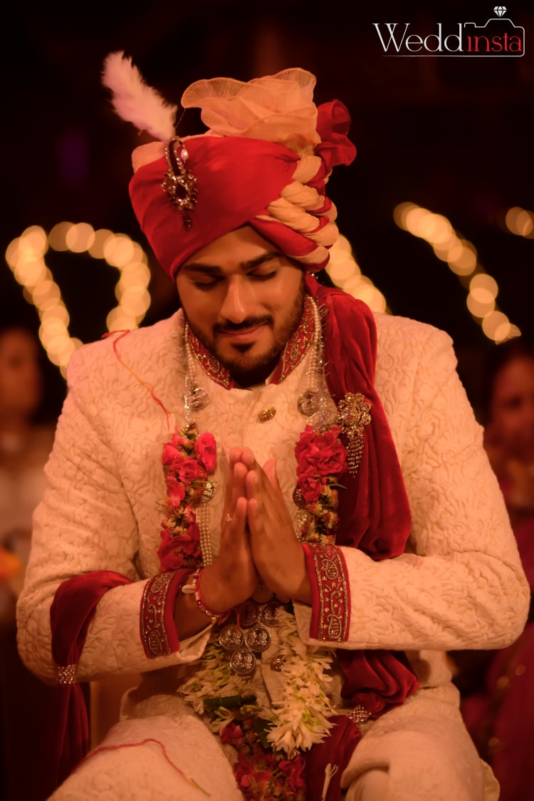 Candid Shot Of The Groom Doing Rituals by Anoop Mahajan Wedding-photography Groom-wear-and-accessories | Weddings Photos & Ideas