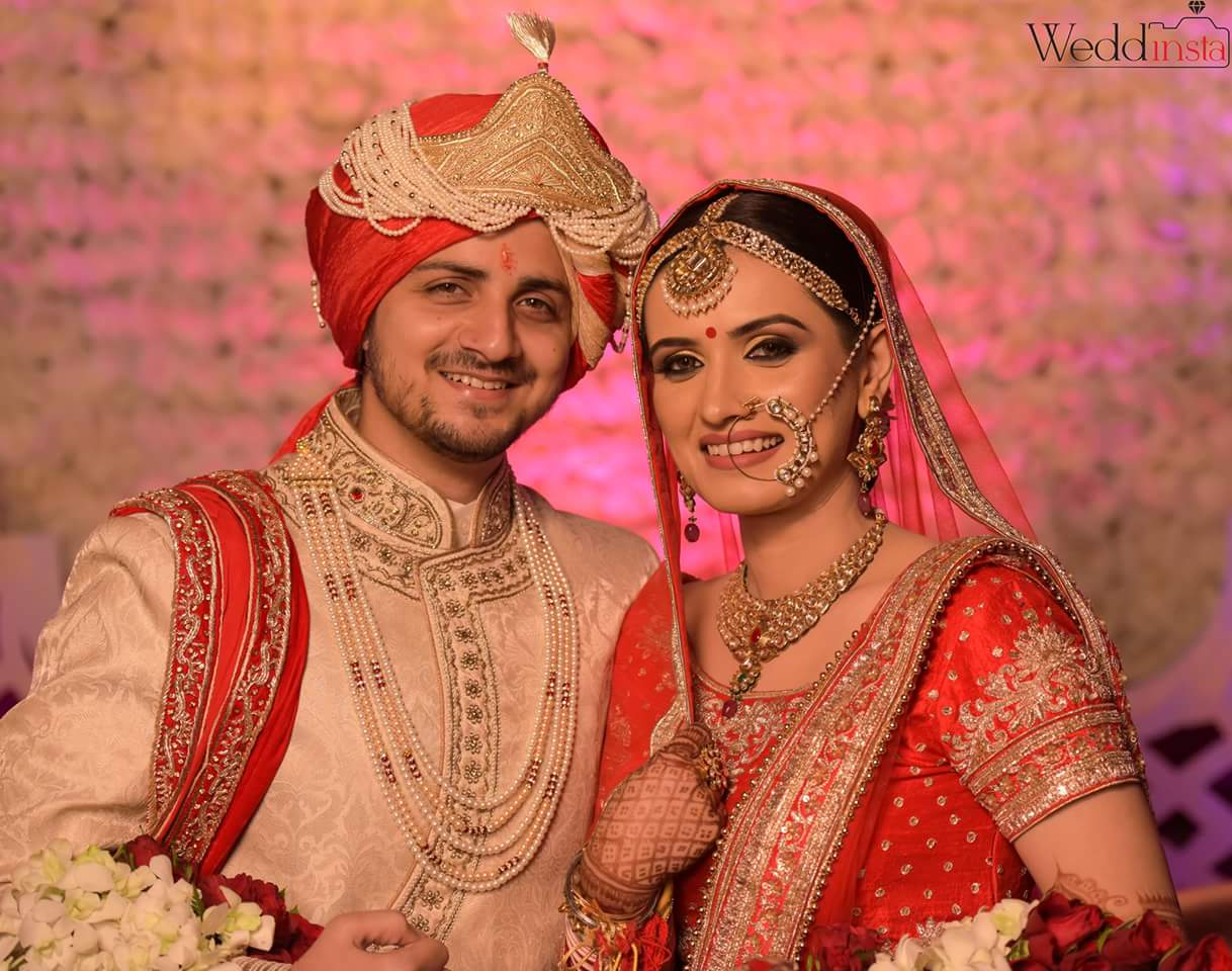Bride And Groom Wedding Portrait by Anoop Mahajan Wedding-photography Groom-wear-and-accessories Bridal-jewellery-and-accessories Bridal-makeup | Weddings Photos & Ideas