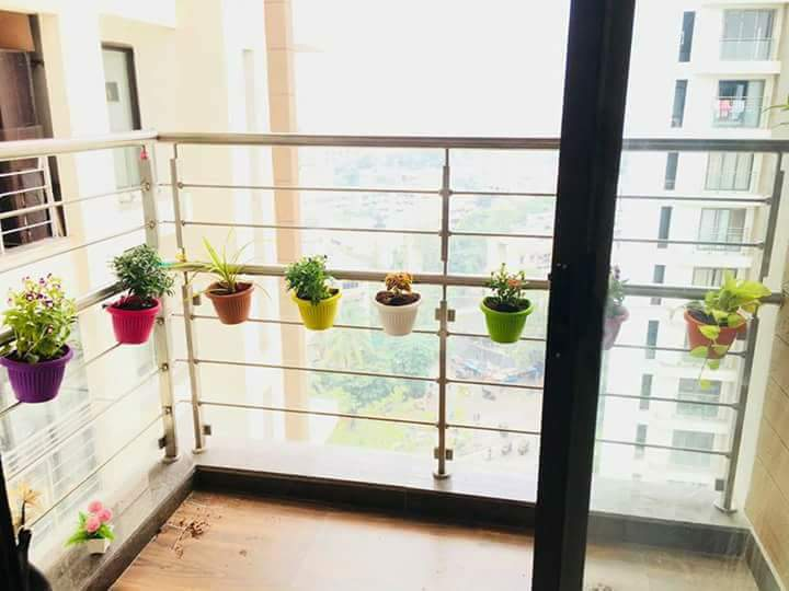 Hanging Plants With Colorful Pots In A Modern Balcony by bala kumar Open-spaces Contemporary | Interior Design Photos & Ideas