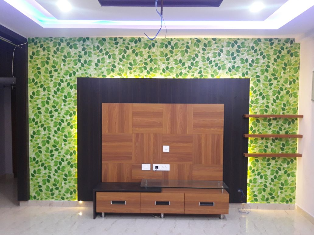 Wooden Credenza Against A Wall With Leaf Green Print Illuminated By Led Ceiling Lights By Prasad