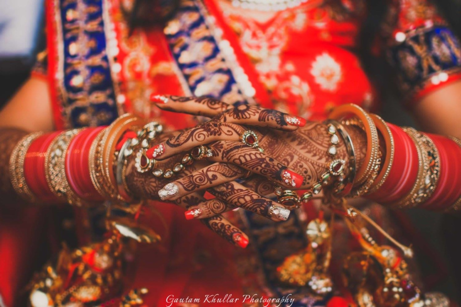 A Close Up Shot Of The Bridal Nails, Jewellery And Mehendi by Gautam Khullar Wedding-photography Bridal-mehendi Bridal-jewellery-and-accessories | Weddings Photos & Ideas