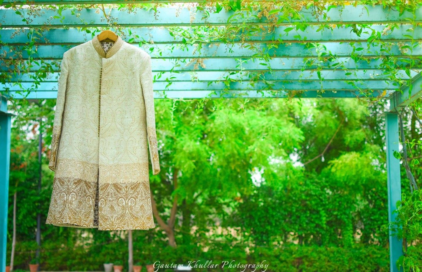 The Groom's Sherwani In White With Golden Detailing And Embroidery by Gautam Khullar Wedding-photography Groom-wear-and-accessories | Weddings Photos & Ideas