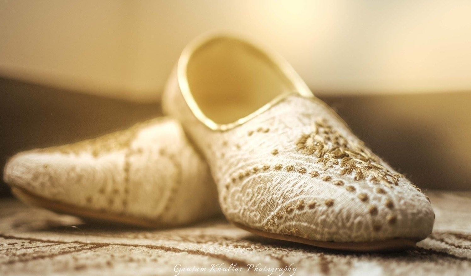 A Shot Of The Groom's Gold And White Juttis For His Wedding Day by Gautam Khullar Wedding-photography Groom-wear-and-accessories | Weddings Photos & Ideas