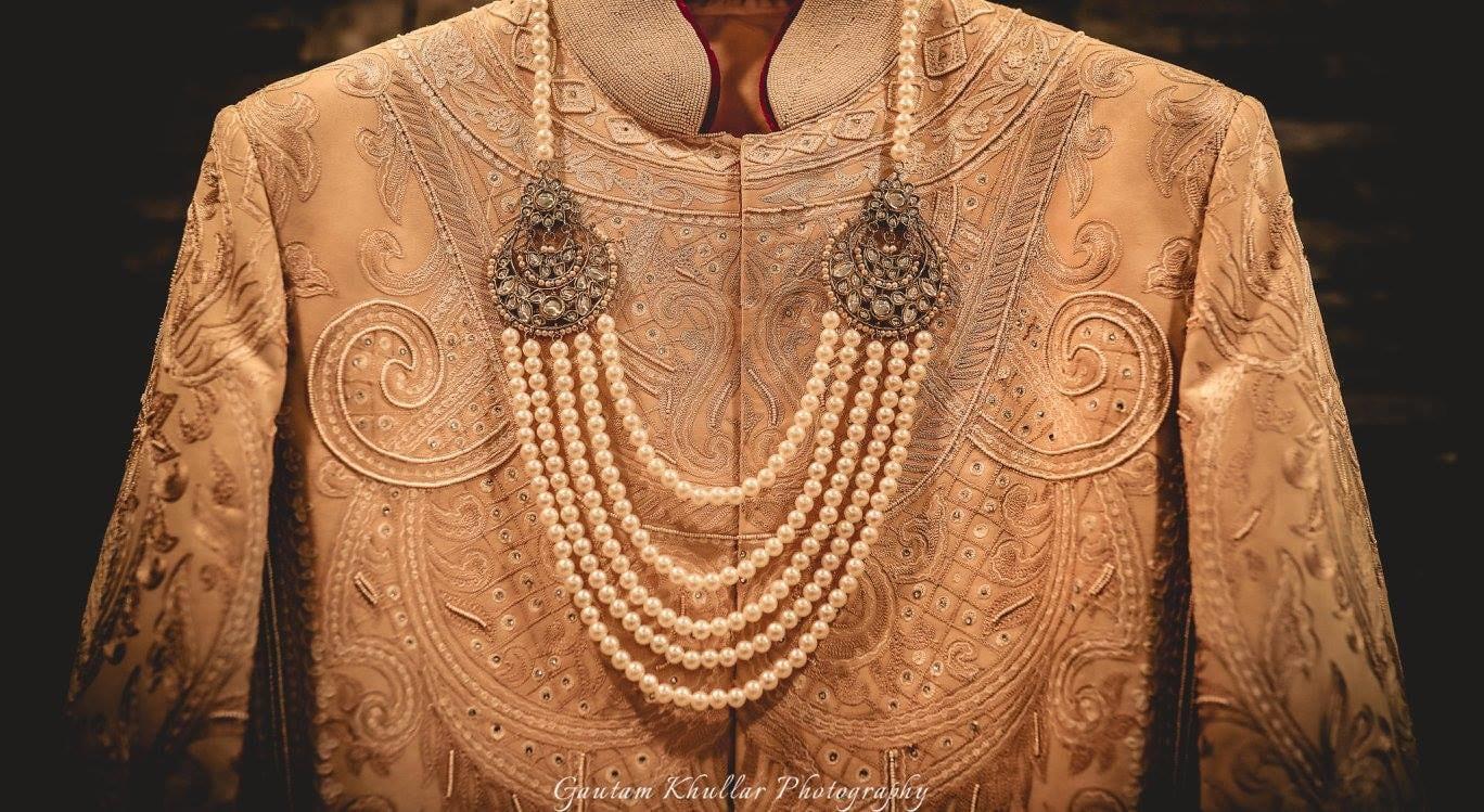 Stunning Beige High Collared Intricate Groom Sherwani With Exquisite Pearl Neckpiece by Gautam Khullar Wedding-photography Groom-wear-and-accessories | Weddings Photos & Ideas