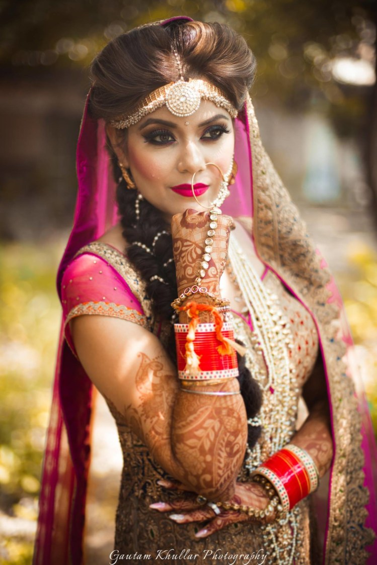 Majestic Headgear With Circular Mang Tikka In Center Going Well With The Bold Makeup by Gautam Khullar Bridal-makeup Bridal-jewellery-and-accessories | Weddings Photos & Ideas
