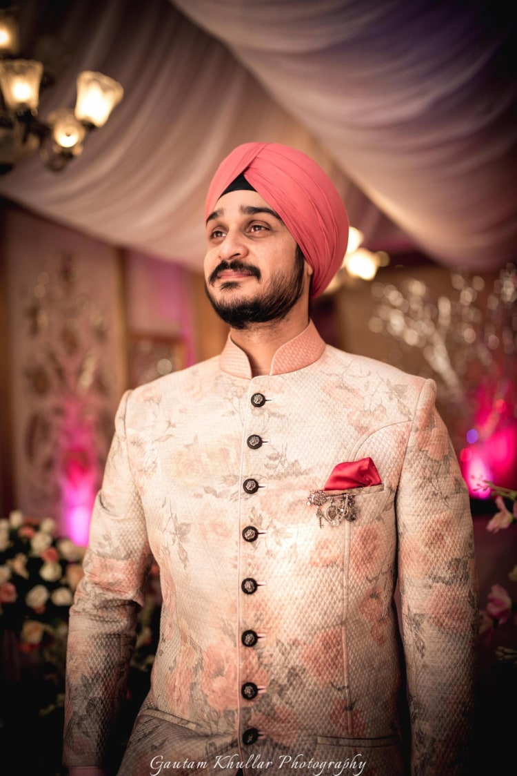 Soft Pink Flower Printed High Collared Sherwani With Black Circular Buttons And Pink Pocket Square by Gautam Khullar Groom-wear-and-accessories | Weddings Photos & Ideas