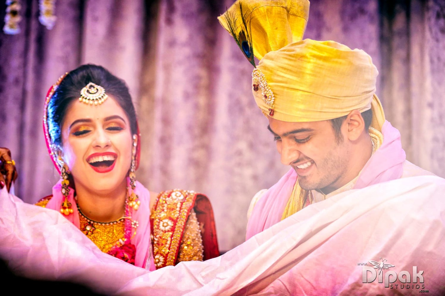 Fun and Frolic Shot Of Bride And Groom On Wedding Day by Kabeer Grover Wedding-photography Groom-wear-and-accessories Bridal-jewellery-and-accessories Bridal-makeup | Weddings Photos & Ideas