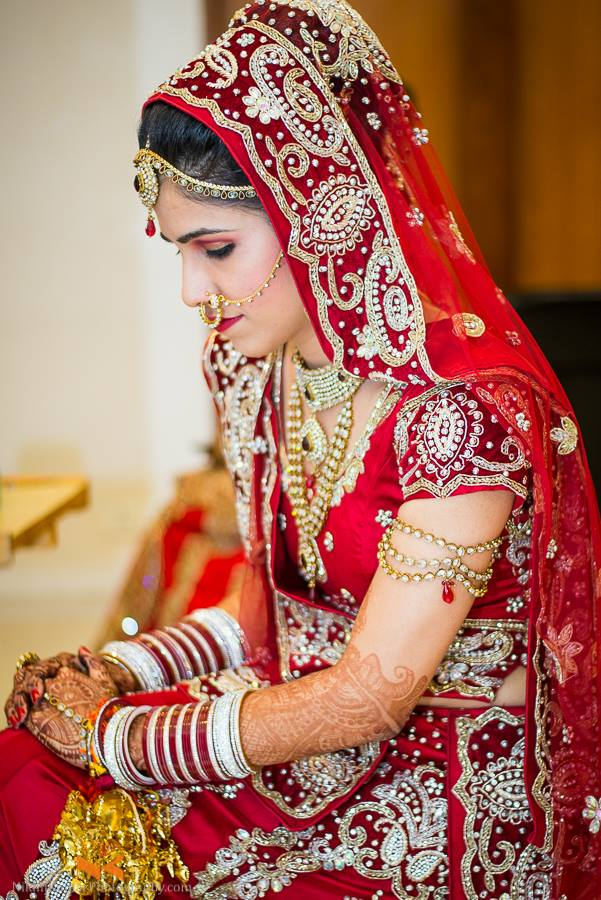 Bride Blushing in red by Nikhil Kumar Bridal-makeup Bridal-jewellery-and-accessories | Weddings Photos & Ideas