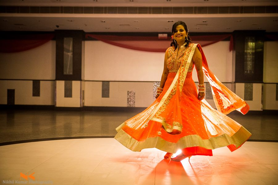 Twirling Bride In Orange by Nikhil Kumar Wedding-photography | Weddings Photos & Ideas