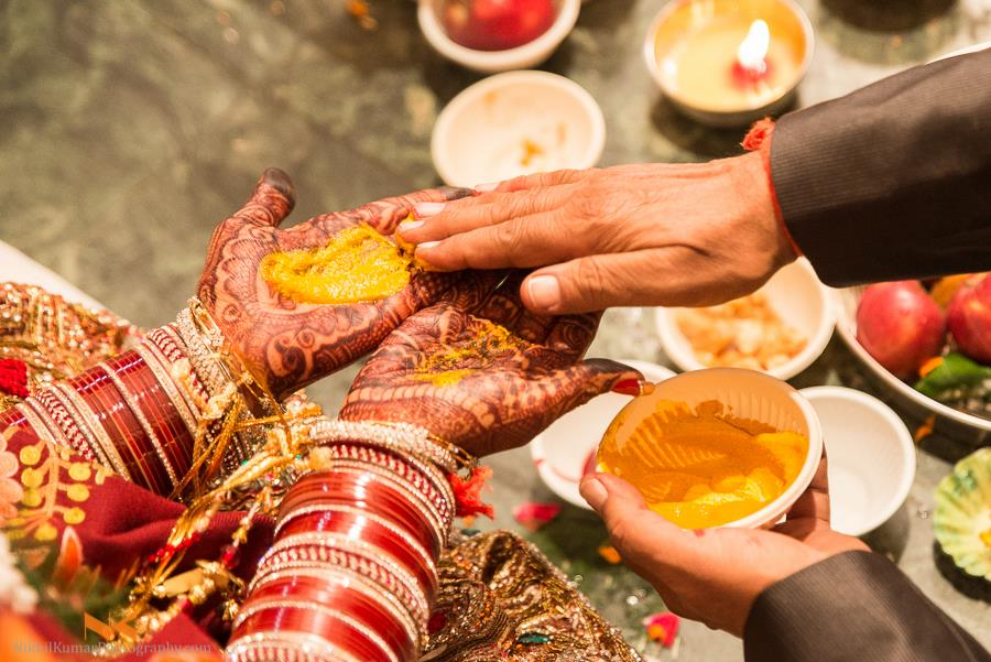 Auspicious Haldi Wedding Ritual by Nikhil Kumar Wedding-photography Bridal-mehendi | Weddings Photos & Ideas