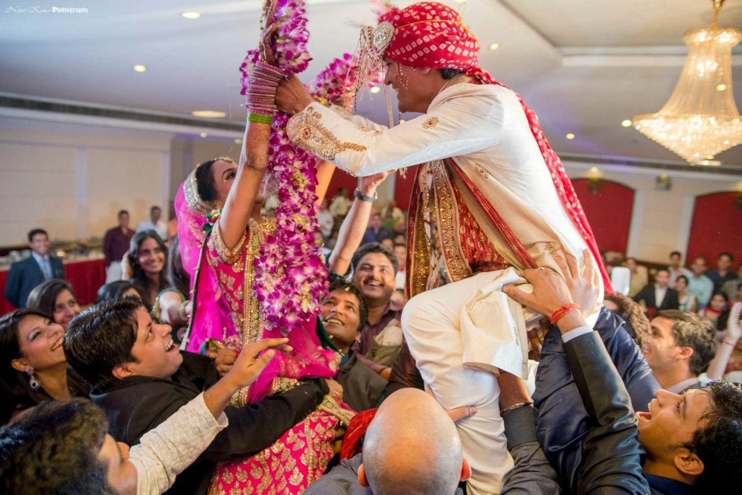 Orchid Garland Varmala Ceremony by Nikhil Kumar Wedding-photography | Weddings Photos & Ideas