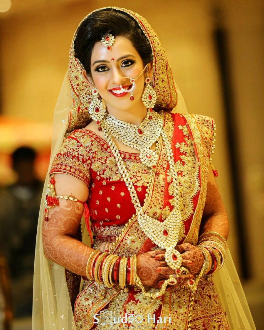 White Jewellery Matching With Red And Golden Lehenga by Anchal Kumar Bridal-makeup Bridal-jewellery-and-accessories | Weddings Photos & Ideas