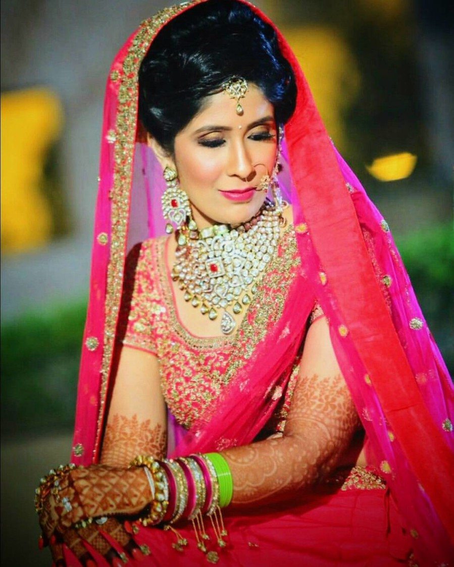 Bride In Pink And Golden Attire With Heavy Kundan Jewellery by Anchal Kumar Bridal-makeup Bridal-jewellery-and-accessories | Weddings Photos & Ideas