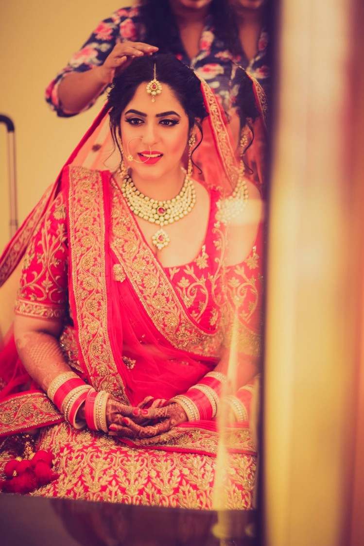 Red and gold motifs by Shruti Sharma Bridal-makeup | Weddings Photos & Ideas