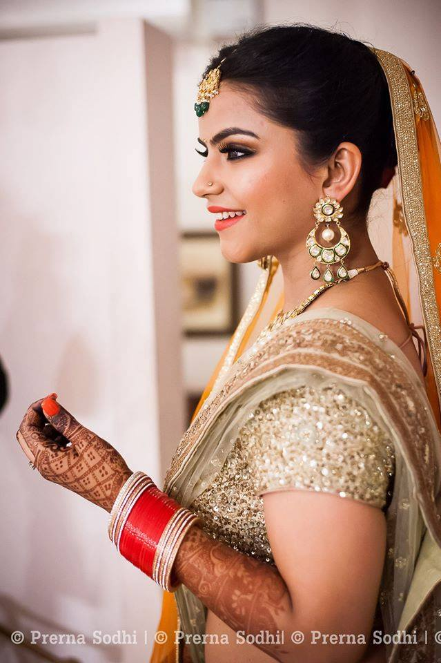 Smiling bride by Shruti Sharma Bridal-makeup | Weddings Photos & Ideas