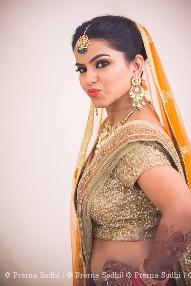 Bride in golden lehenga by Shruti Sharma Bridal-makeup | Weddings Photos & Ideas