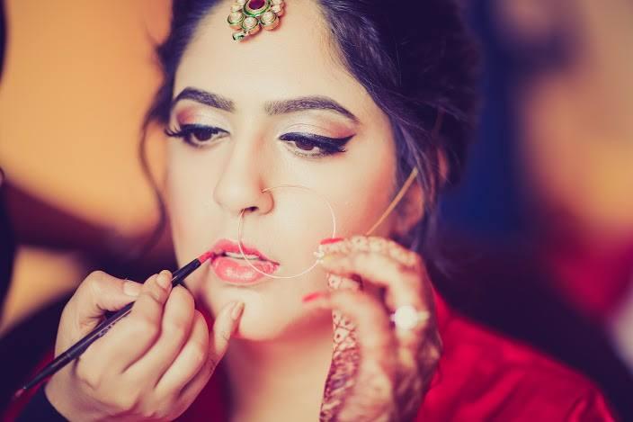 Bride getting ready by Shruti Sharma Bridal-makeup | Weddings Photos & Ideas