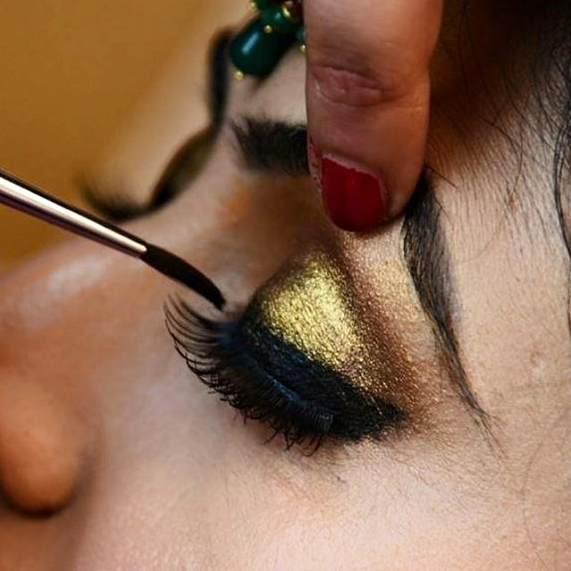 Shimmery golden eye shadow by Shruti Sharma Bridal-makeup | Weddings Photos & Ideas