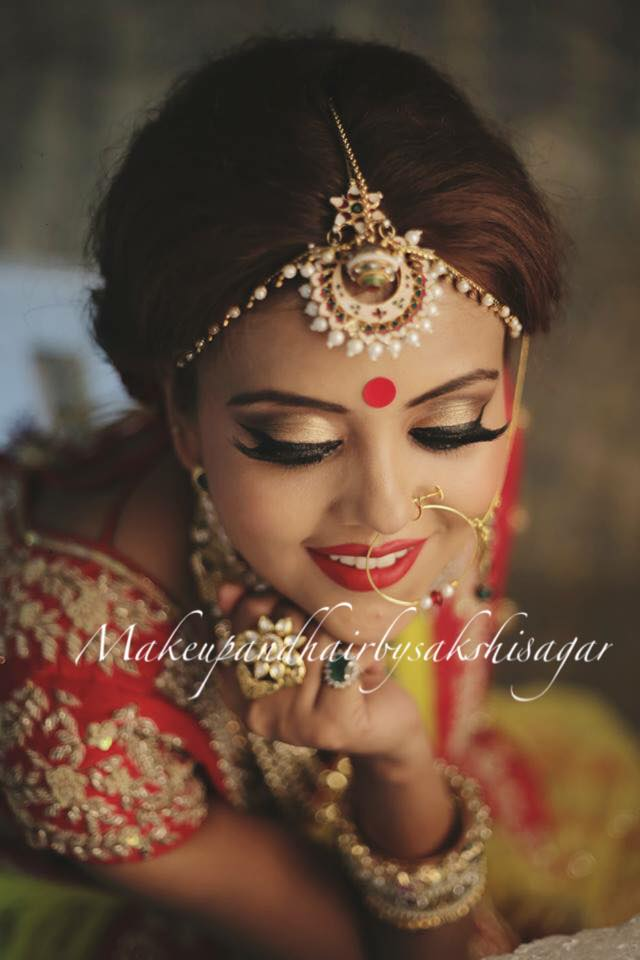 Bindi completing her Bridal look by Sakshi Sagar Bridal-makeup | Weddings Photos & Ideas