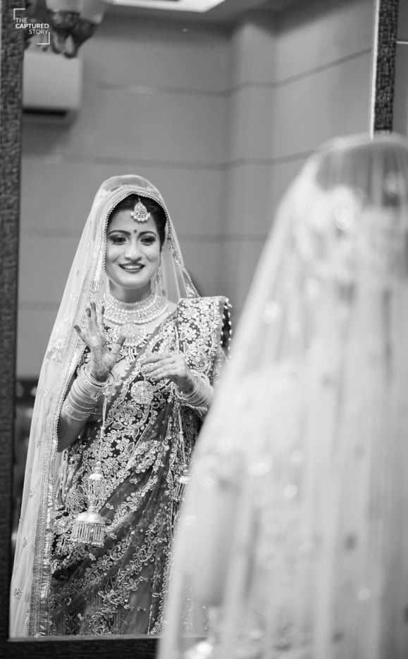 Admiring her bridal look by Captured Memories Wedding-photography | Weddings Photos & Ideas